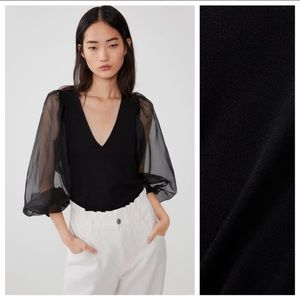 NWT. Zara Black Shirt with Puff Sleeves. Size S.